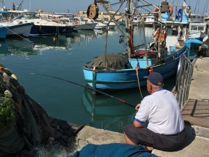 Fisherman with fishing pole in Jaffa