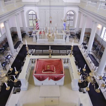 """In this Thursday, May 28, 2015 photo Touro Synagogue, the nation's oldest, is seen from the """"ladies gallery"""" in Newport, R.I. Women attend synagogue seated on the second floor while men take their places on the ground floor. A federal judge has allowed the state of Rhode Island to intervene in a fight over the future of the synagogue by a lawsuit, due for trial Monday, June 1, which pits the nation's first Jewish congregation in New York City against the congregation that worships at the 250-year-old Touro Synagogue.  (AP Photo/Stephan Savoia)"""